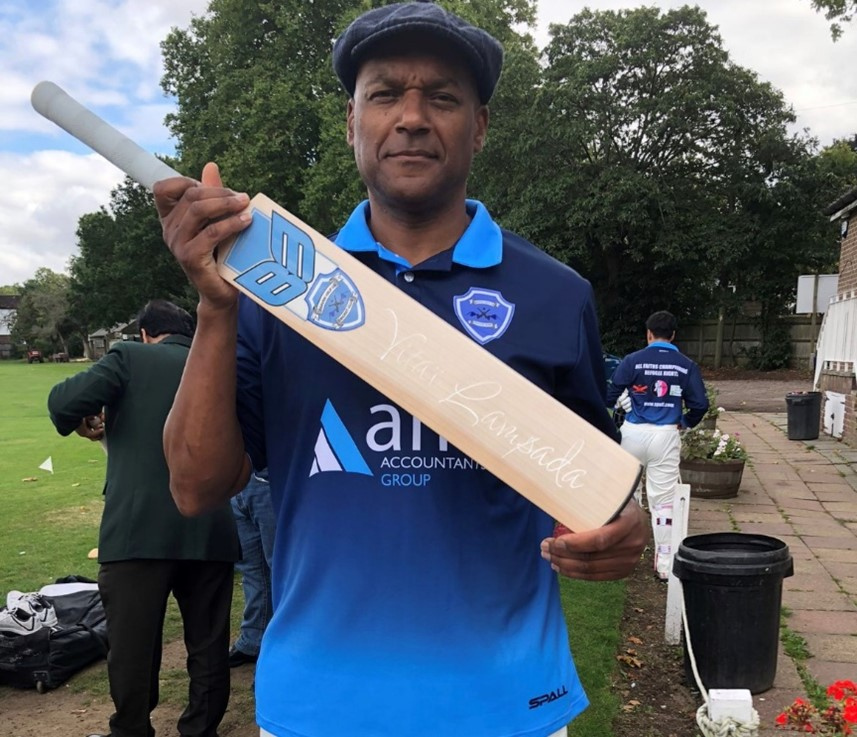 Cricketer and actor, Colin Salmon, holding the Vitai Lampada bat made for Heaven Help Us CC by B3